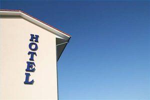¿Dónde puedo encontrar hoteles baratos Rooms?
