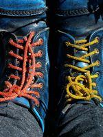 Las instrucciones para que ata la cremallera Inserciones en las botas Thorogood