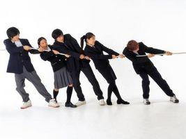 Cómo Roll Up traje de campaña mangas uniformes
