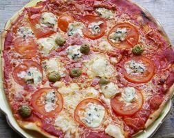 Cómo volver a calentar la pizza congelada en un horno convencional