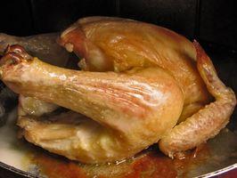 Cómo hervir un pollo antes de hornear