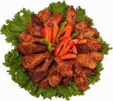 Cómo cocinar o calentar totalmente congeladas alitas de pollo cocinadas