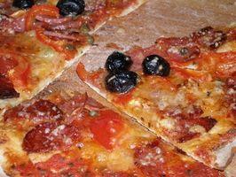 Caseras bandejas para hornear pizzas a la piedra