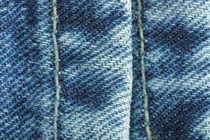Cómo coser dardos para reducir la cintura de los pantalones vaqueros