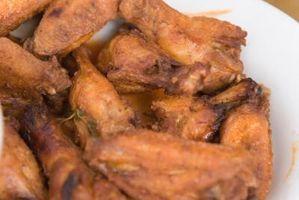 Cómo cocer al horno las alas de pollo congelado
