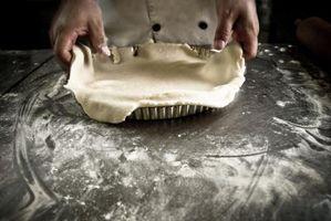 ¿Cómo se puede evitar la contracción al cocer al horno tarta de los depósitos vacíos?