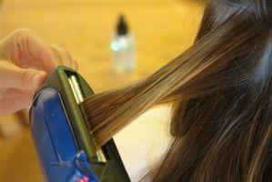 Como el hierro plano del pelo correctamente