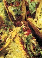 ¿Cuánto preparado de antemano condimento para tacos se usa a la de una libra de carne molida?
